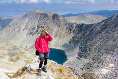 Woman backpacker standing mountain. Royalty Free Stock Photos