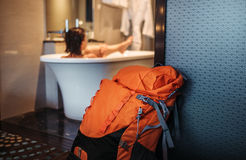 Woman backpacker traveler take a bath in high quality hotel Stock Photography