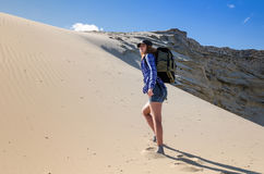 Woman backpacker traveling in the desert Royalty Free Stock Images