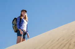 Woman backpacker traveling in the desert Stock Images