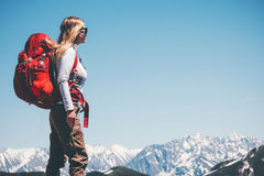 Woman backpacker traveling in mountains. Travel Lifestyle concept adventure active vacations outdoor hiking sport Stock Image
