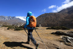 Woman backpacker trekking on himalaya mountains Stock Photos
