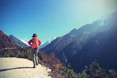 Woman backpacker trekking on himalaya mountains Royalty Free Stock Photo