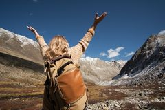 Woman backpacker trekking in wild mountains stock photography