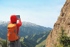 Woman backpacker use digital tablet taking photo Stock Photo