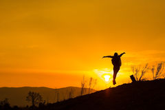 Woman backpacking to watch the sunset.Silhouette.  Royalty Free Stock Photography