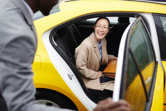 Woman on backseat Stock Photography