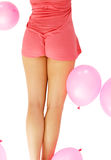 Woman backside with pink air balloons Royalty Free Stock Photos