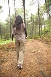 Woman backwards on brown path Royalty Free Stock Image