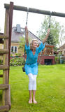 Woman on backyard swing Royalty Free Stock Photo