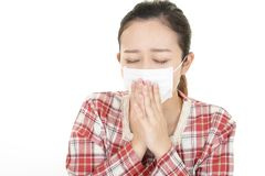 Woman got a cold. Woman in bad condition having flu royalty free stock image
