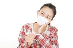 Woman got a cold. Woman in bad condition having flu stock photo