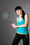 Woman with badminton racket Stock Photos