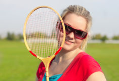 Woman with badminton racquet Stock Photo