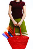 Woman with a bag. Modern woman (artist) with a full red bag, on white stock images