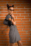 Woman with bag. Beautiful woman with bag on brick background Stock Photos