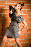 Woman with bag. Beautiful woman with bag on brick background Royalty Free Stock Images