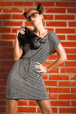 Woman with bag. Beautiful woman with bag on brick background Stock Photography