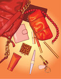 Woman bag. Red bag with typical woman things and accessories Stock Photos