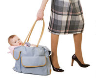 Woman with a bag and baby Stock Photography