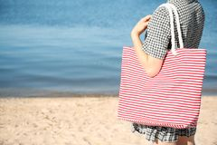Woman with bag on beach. Space for text royalty free stock photography