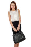 Woman with bag in black skirt over white Stock Image