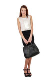 Woman with bag in black skirt over white Royalty Free Stock Image
