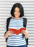 Woman with bag and book Stock Photography