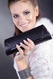 Woman with bag clutsch Royalty Free Stock Images