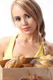 Woman with a bag full of fresh baked bread Royalty Free Stock Image