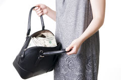 Woman with a bag full of money in the hands of Royalty Free Stock Photography