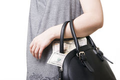 Woman with a bag full of money in the hands of Stock Images