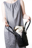 Woman with a bag full of money in the hands of Stock Photography