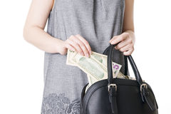 Woman with a bag full of money in the hands of Stock Photo