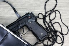 Woman bag with gun hidden, Handgun and accessories. Royalty Free Stock Images