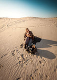 Woman with bag lost in desert Royalty Free Stock Images