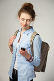 Woman with bag and mobile phone Stock Photo