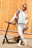 Woman with bag and scooter Stock Photos