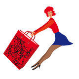 A woman with a bag of shopping Stock Photography