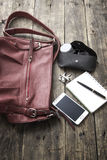 Woman bag stuff, handbag. Over rustic wooden background Stock Photography