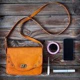 Woman bag. Stuff, handbag on wooden desk Stock Photos