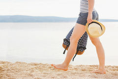 Woman with bag and sun hat going on the beach Royalty Free Stock Images