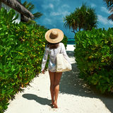 Woman with bag and sun hat going to beach Stock Image