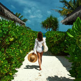 Woman with bag and sun hat going to beach Royalty Free Stock Photo