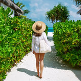 Woman with bag and sun hat going to beach Stock Images
