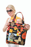 Woman with a bag and sunglasses Royalty Free Stock Photo