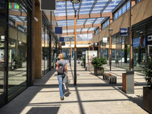 Woman with a bag walking in shopping mall Royalty Free Stock Photography