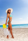 Woman with bag walking to the beach Stock Photos