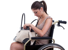 Woman with bag on the wheelchair Stock Photography
