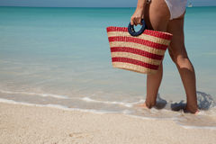 Woman with bag at white sand beach Royalty Free Stock Photos